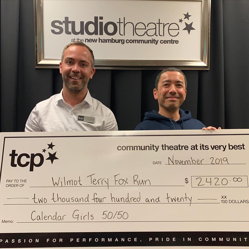 TCP President Aaron Fewkes with Wilmot Terry Fox Run co-organizer Nigel Gordijk. The donation total shown on the presentation cheque doesn't include $267 that Calendar Girls audience members left on the set as they left the final performance. Photo: TCP