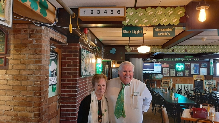 Linda and Mike Kennedy under the old servers' number sign that once helped romance to blossom at Kennedy's Restaurant in St. Agatha.