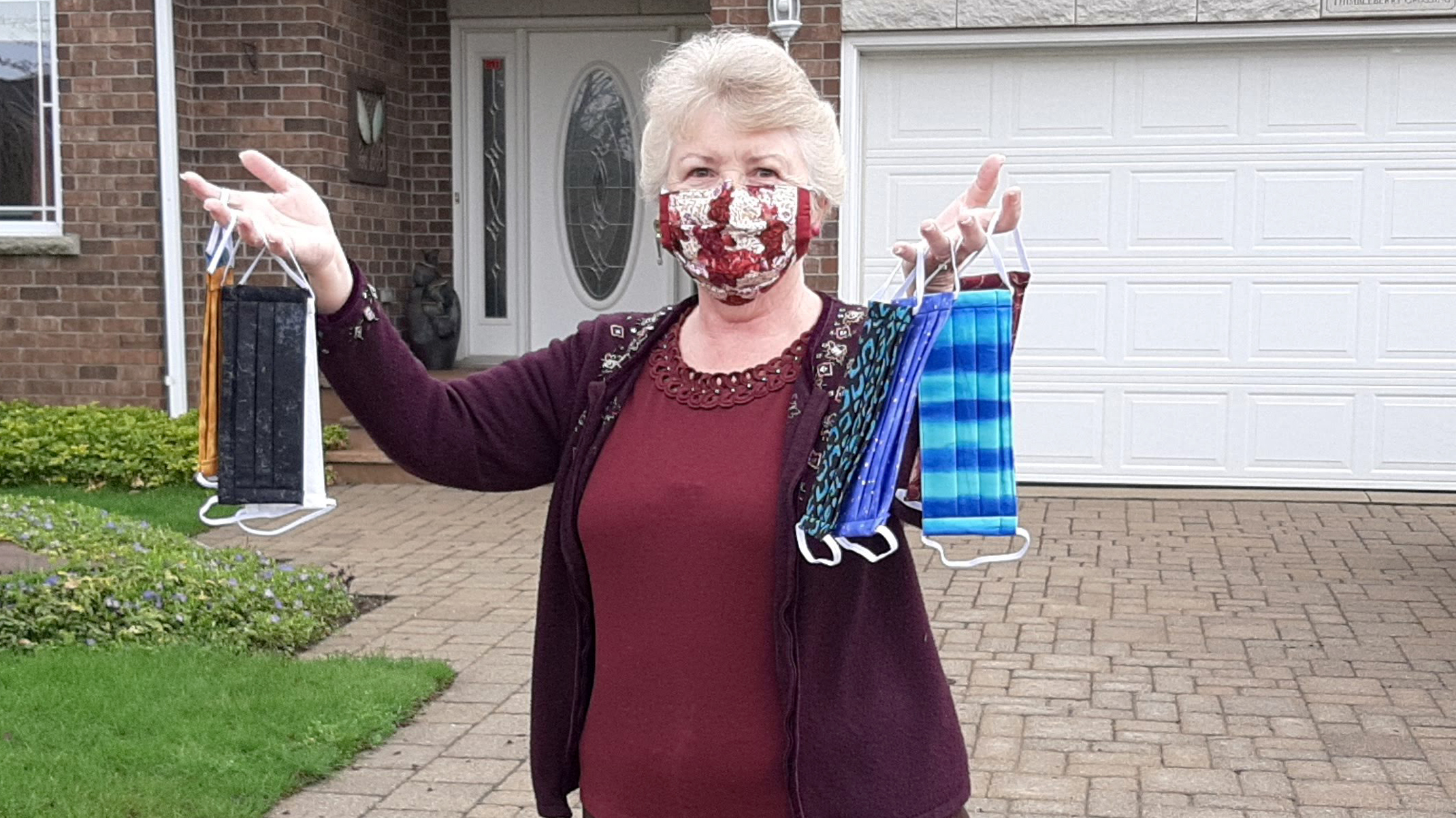 Stonecroft resident Linda Brodrecht with some of the 320 fabric face masks she's produced, which have helped raise nearly $12,500 for St. Mary's General Hospital. Photo Nigel Gordijk