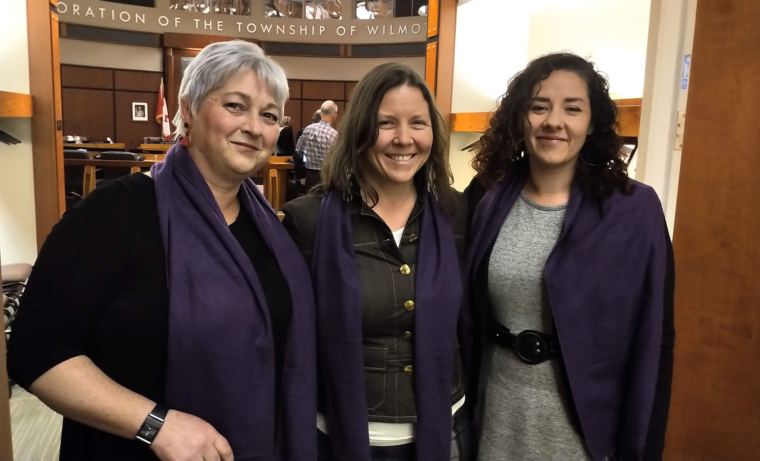 Wilmot councillors Cheryl Gordijk, Jenn Pfenning and Angie Hallman wore Wrapped In Courage purple scarves in support of the Women's Crisis Services of Waterloo Region. Photo by Ekk Pfenning